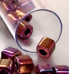 Bronze 4mm TOHO cubes in a 5.5 inch tube