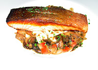 Scottish Organic Salmon served over chive spaetzel with wild mushrooms & rosemary broth
