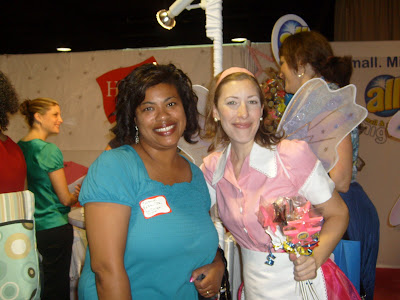a woman at a blogging conference with a lady dressed as a fairy