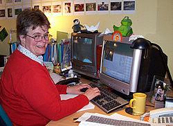 Here I am, Rosi Crane, at my desk.