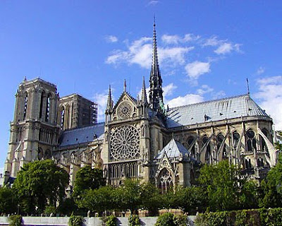 daytime photo of notre dame cathedral in paris france blue sky taken from seine river