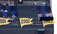 The 2003 division pennant is unfurled at Turner Field on Sept. 19.