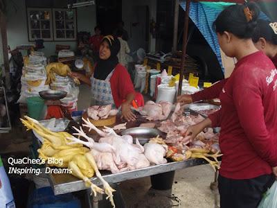thai night market, phuket, thailand - yellow chicken