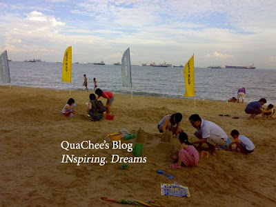 east coast park, singapore, beach, family building sandcastle