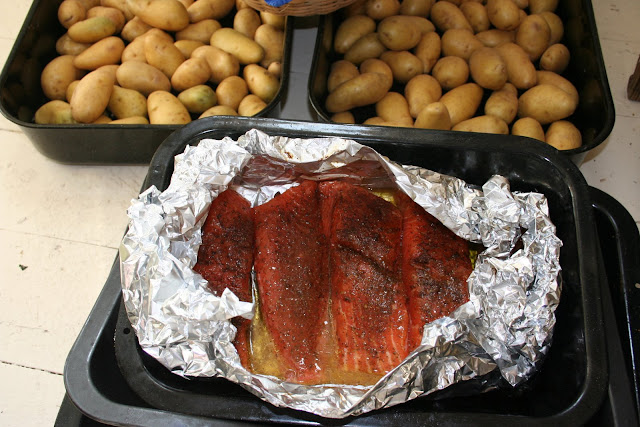 Salmon smeared with blackened seasoning, in a pouch of olive and walnut oil, white wine