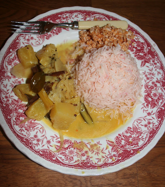 Pineapple and coconut curry with basmati saffron rice and fresh coconut sambal.