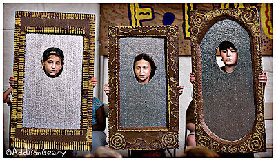Three children depicting Magic Mirrors in school play.