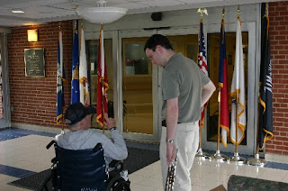 Justin Dixon talking with one of the residents of the NC Veterans Home