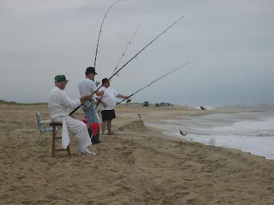 Richard Eller, Wayne Eller, and Jonathan Eller surf fishing at Avon, NC
