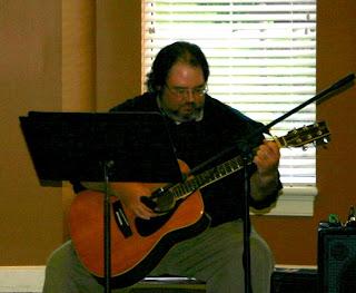 Jonathan Eller playing guitar at Trinity Oaks Retirement Community