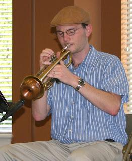 Justin Dickson playing trumpet at Trinity Oaks Retirement Community