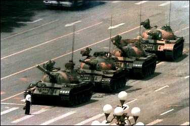 Lone protester resisting Chinese tanks in the Tiananmen Square Massacre