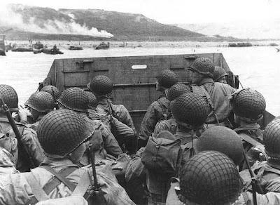 Soldiers in an amphibious landing craft approach Omaha Beach June 6, 1944