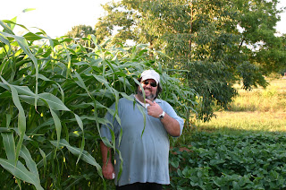 Jonathan Eller being dwarfed by his corn