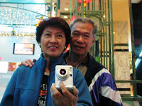 John and I, fooling around in front of a mirror at Genting Hotel