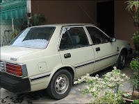 Light green Nissan Sunny 130Y parked at our car porch