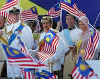 Our King, Tuanku Mizan Zainal Abidin and Queen, Tuanku Nur Zahirah waving the Jalur Gemilang during the Merdeka Day Parade at Dataran Merdeka. Looking on are Britain's Prince Andrew and Minister of Housing & Local Government Datuk Seri Ong Ka Ting
