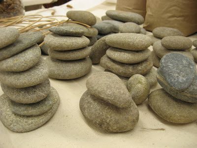 Erin Curry close up of studio table with stacks of oval stones
