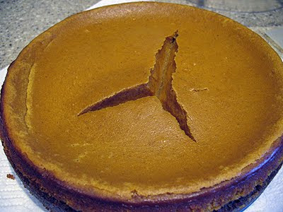 A close up photo of a pumpkin cheesecake.