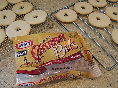 A photo of a bag of Kraft caramel bits and cookies resting on cooling racks in the background.