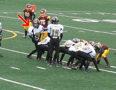 A photo of Amanda\'s son TJ on the field playing football.