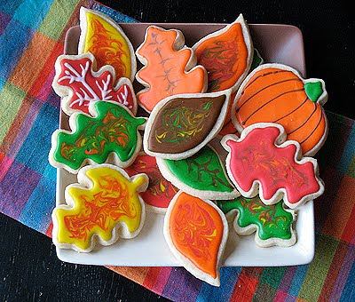 An overhead photo of an assortment of thanksgiving cookies resting on a plate.