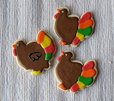An overhead photo of three thanksgiving turkey cookies.