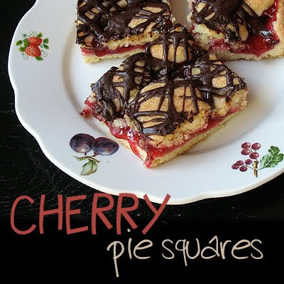 An overhead photo of cherry pie squares on a white plate.