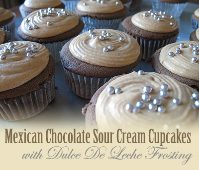 A close up photo of Mexican chocolate cupcakes with dulce de leche frosting.