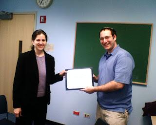 Drew receiving his chaplaincy certificate from Rabbi Naomi Kalisch