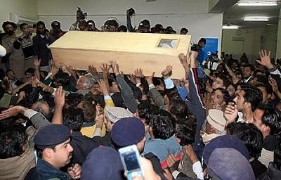 Benazir Bhutto's coffin been taken away for burial