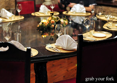 A line-up of Russian dolls overlook a medieval-style table. We delight in our stately table - a huge glass topped oval table with heavy carved wooden legs. & The Coachmen Russian Restaurant Surry Hills | Grab Your Fork: A ...