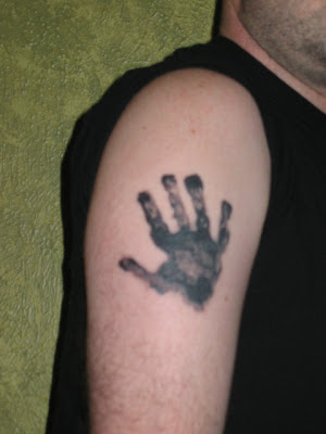 Handprint tattoo