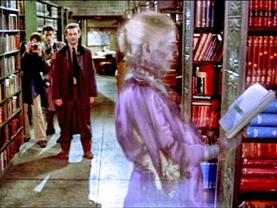 The Ghostbusters stumble upon a ghostly specter in the stacks.