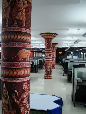 Painted pillars in Tenth Planet office