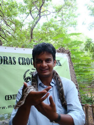 Ravi holding a live snake at crocodile bank
