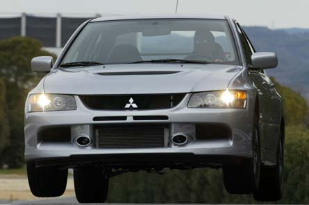 0503_04%2B2006_Mitsubishi_Lancer_Evolution_IX%2BFront_Drivers_Side_View_In_The_Air