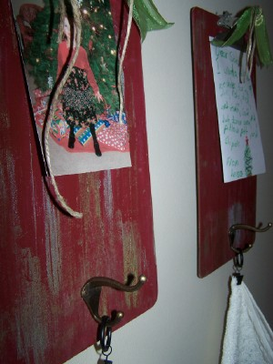 clipboard stocking holder http://bec4-beyondthepicketfence.blogspot.com/2010/12/12-days-of-christmas-ideas-day-9.html