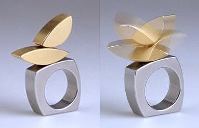 Stainless steel and 18k gold kinetic rings