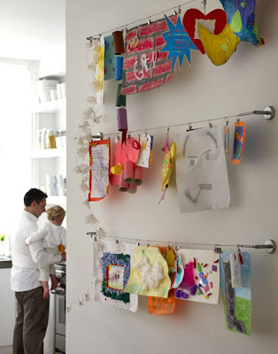 hanging children's art on a line