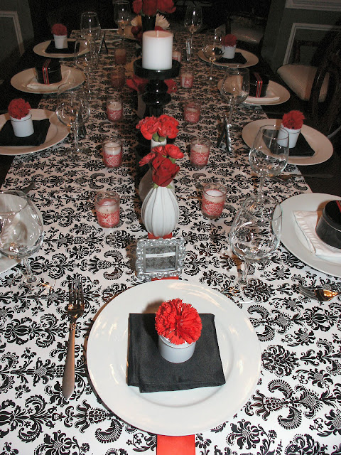 The table was set so that the place settings for the men were slightly different than the place settings for the women. I used decorative red damask packing ... & A Farewell Dinner Party Black White u0026 Red - Celebrations at Home