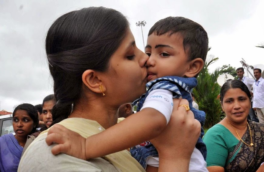 An Indian nurse, who was among 46 nurses stranded in territory held by Islamic extremists in Iraq, kisses her nephew upon arrival at the airport in Kochi, India, Saturday, July 5, 2014. The nurses who had been holed up for more than a week in Tikrit, returned home to southern India on Saturday aboard a special flight, officials said.